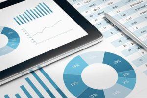 digital tablet and financial report on table